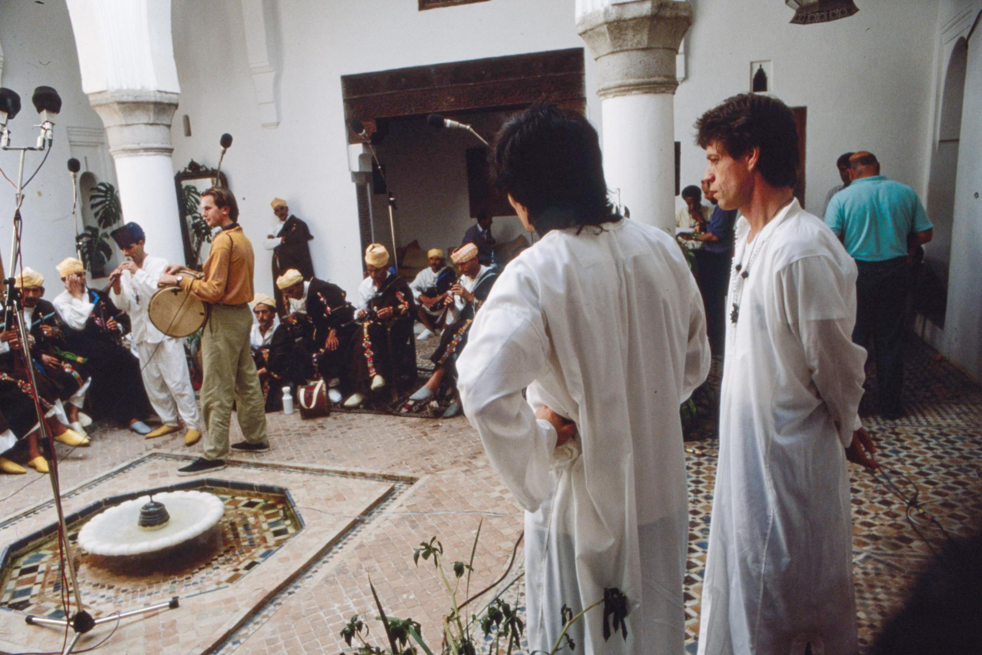 Ronnie and Mick look on at the Jajouka musicians during the recording of Continental Drift